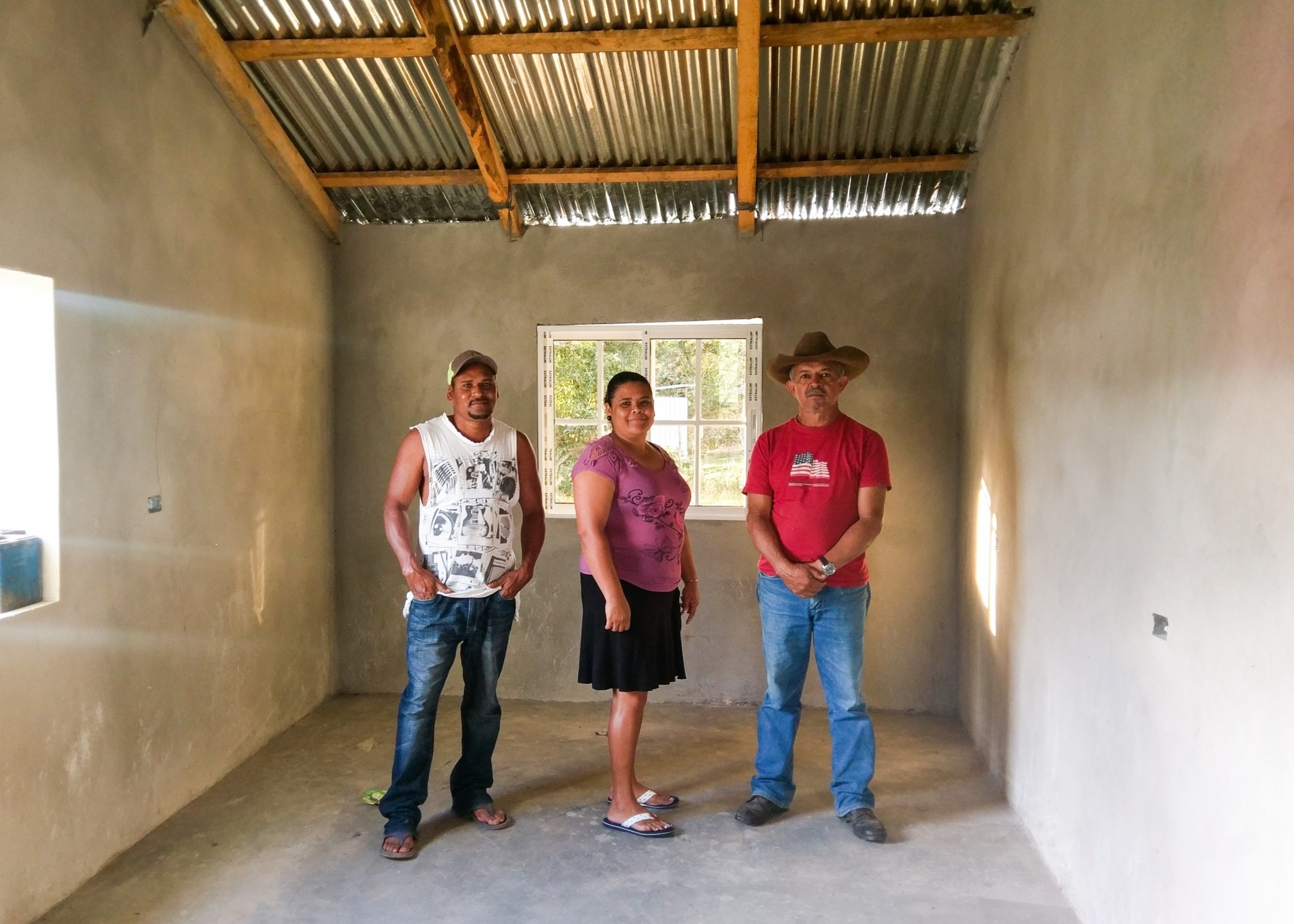 (April) Orica, Honduras-- Roger, Elena and their two kids lived in an unsafe home with walls that exposed the outdoors. Iglecia Centro Americana La Fe served this family by installing new windows, floors, fixing the cracked walls and providing electricity! The couple was not open to hearing the gospel message before the construction but during the project the pastor was able to share with Jesus' love with them. They now accept visits from the pastor and are building a relationship with their local church.