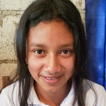 Evelyn is a 15-year-old who has a brother and sister. She loves to study and one day would like to be a teacher.