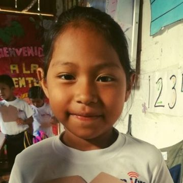 Karla is in kindergarten and enjoys playing with her school friends. When she grows up, she wants to be a preschool teacher.